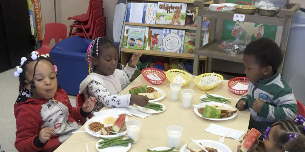 Children eating lunch provided by Alta Head Start